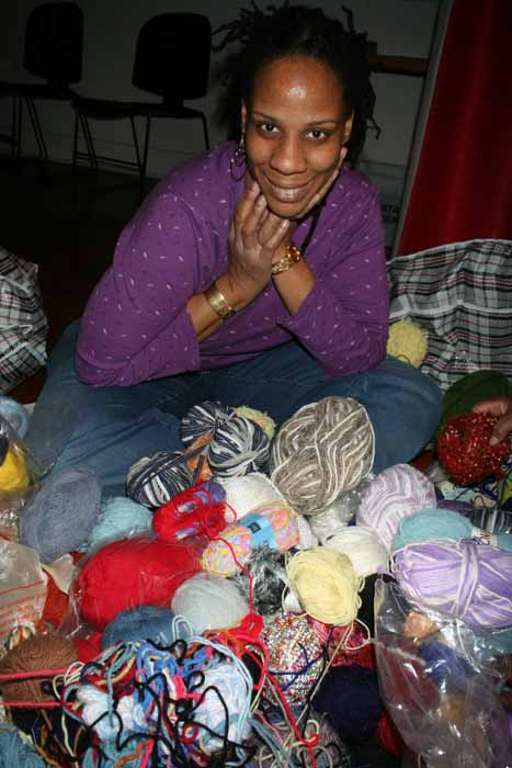 Njoya giving out yarn for CR project