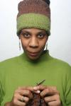 Njoya_knitting_in_the_green